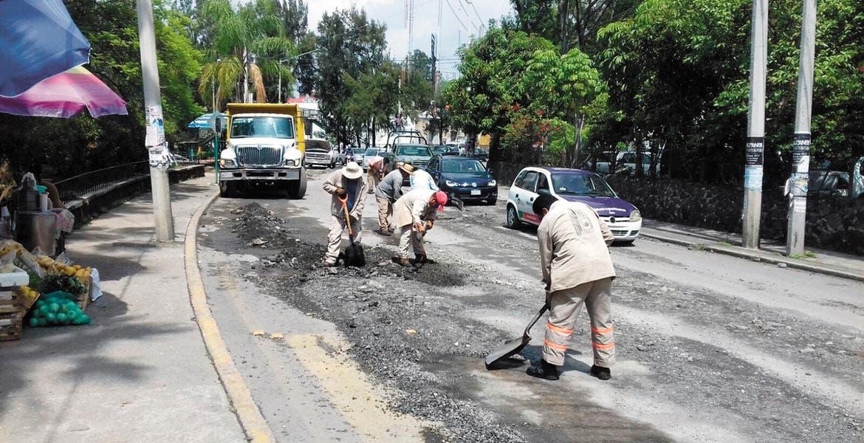 Daños. El asfalto se levantó en avenida Universidad, al norte de la capital, por lo que las cuadrillas municipales tuvieron que resanar esta vía, una de las más transitadas