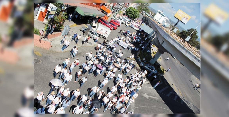 Amenaza. El grupo encabezado por el rector Alejandro Vera amagó con radicalizar el tono de la protesta.