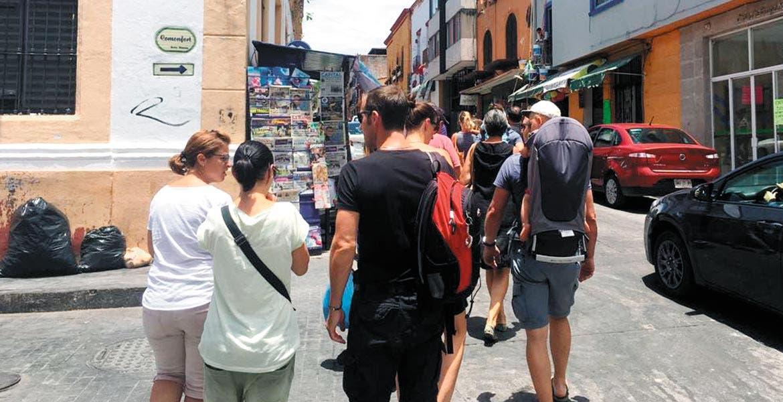 Visitantes. Las obras en el Centro Histórico de Cuernavaca provocan que menos morelenses acudan a éste; en contraparte, llegan más turistas extranjeros