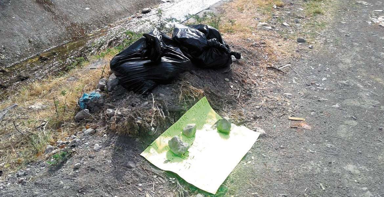 Diligencias. Un hombre fue descuartizado y abandonado en dos bolsas negras junto con un mensaje, afuera del panteón de Zacatepec.