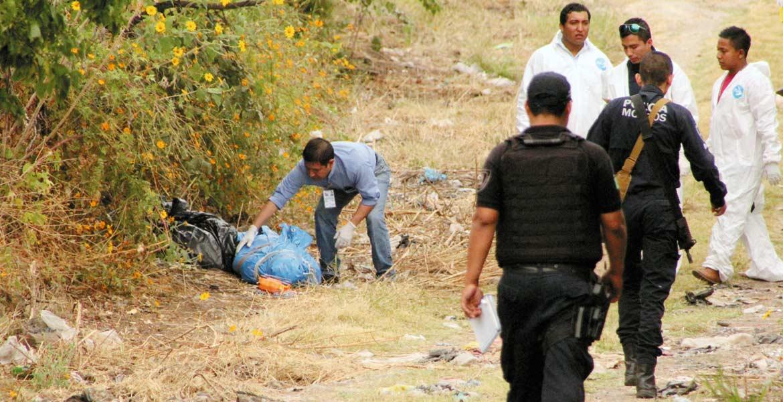 El cadáver. Un hombre fue asesinado a golpes, embolsado y abandonado en la colonia Tres de Mayo, de Emiliano Zapata.