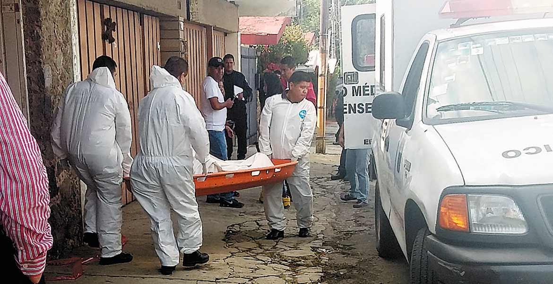 Levantamiento. Personal de Servicios Periciales acudió a la tortillería para las diligencias de rigos, indicando que no encontraron indicios de violencia en la escena de los hechos.
