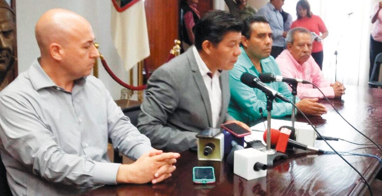 Rueda de prensa. El secretario de Gobierno, Matías Quiroz Medina, acompañado por el fiscal Javier Pérez Durón, anunció que están plenamente identificados quienes están generando un ánimo de confrontación en los transportistas