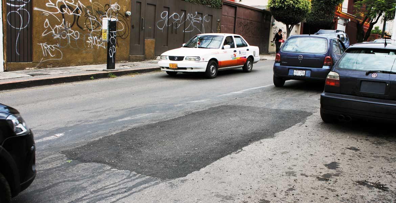 Meta. Un 70 por ciento de avance lleva el bacheo de calles y avenidas en la capital.